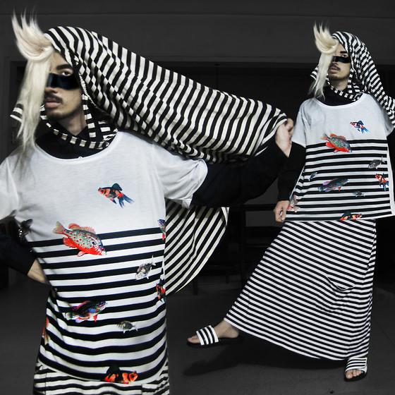Andre Judd - Striped Habit With Straps, Handpainted Face, Odyll Studios By Rayan Fish And Strips Print Tee, Full Striped Skirt, Adidas Striped Slipons - FISH N' STRIPS