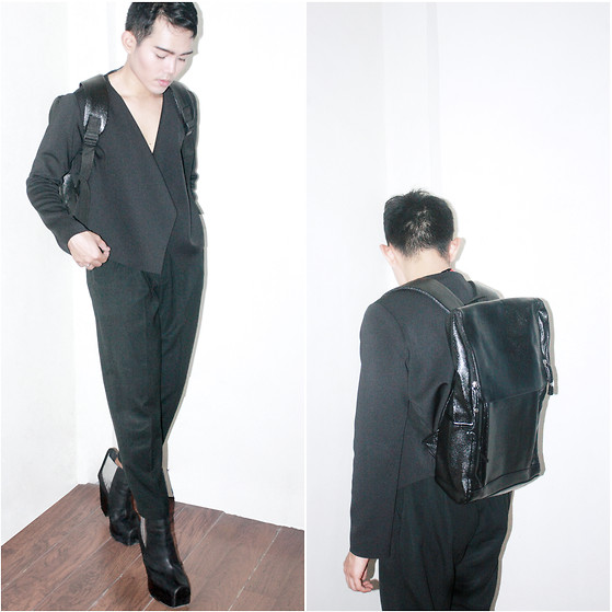 Karl Philip Leuterio - The.Collective Minimal Leather Backpack, Ninthsheep Neoprene Cover Up, Thrifted Carrot Trousers, Messeca Boots - D i s p r o p o r t i o n