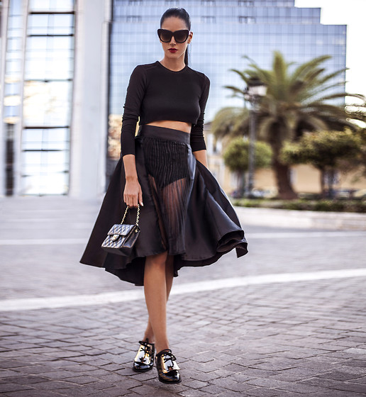 Konstantina Tzagaraki - Skirt, Top, Chanel Purse, Sunglasses - There are years that ask questions and years that answer..