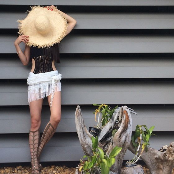 Emma Lee - Bebe Swimsuit, Stuart Weitzman Gladiator Sandals, H&M Straw Hat - Cutouts and gladiator for the summer