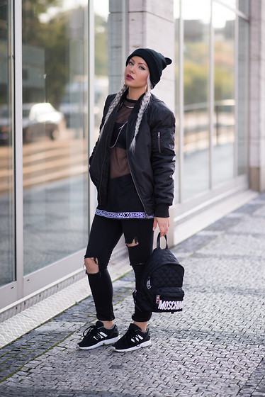 Olga Oliwye Soukupova - Gladiator Brand Black Bomber Jacket, Moschino Black White Quilted Logo Backpack, Adidas Zx Flux 3 Stripes Black And White Perforated Sneakers, Shade London Sheer Black Top Dress, Zara Black Ears Beanie - WET BANDIT