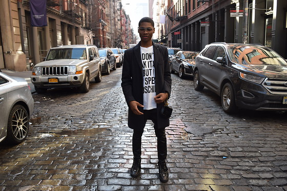 Tyric Davon'e - Moschino White Graphic T, Saint Laurent Wristlet, Balenciaga Black Trainers - OREO