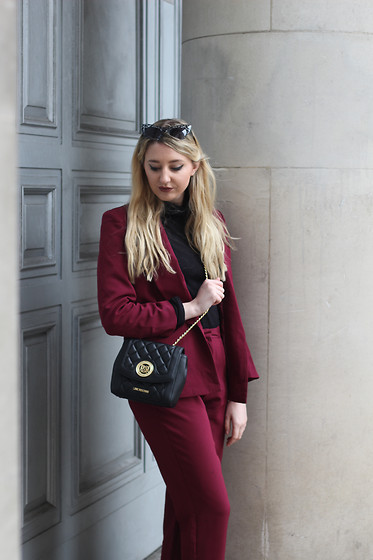 Laura Rogan - Boohoo Sunnies, Moschino Bag, In The Style Jacket, In The Style Trousers - London Fashion Week Day 2