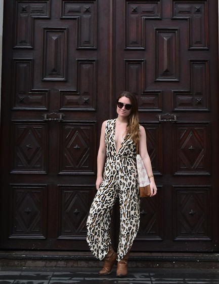 Noelle Lynne - Prada Sunglasses, Hot As Hell Sustainable Leopard Jumpsuit, The Frye Company Ankle Boots, Jenna Aliyah Vegan Leather Tote Bag - Exploring Medellin