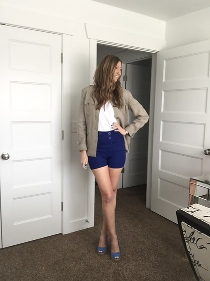 Cindy Batchelor - Hde Blue High Waisted Sailor Shorts, Orvis Khaki Safari Jacket, Orvis High Crew Neck White Tank Top - Blue High waisted shorts, khaki jacket and tank