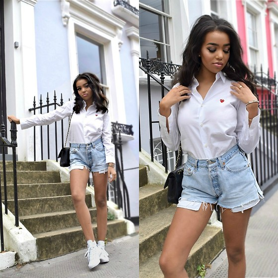 Daphne Blunt - Commes Des Garcons White Button Up Shirt, Re Done Denim Cut Off Shorts, Converse White High Top Sneakers, Chanel Classic Black Flap Bag - Notting Hill
