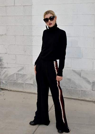 Dani Mikaela McGowan - Gap Black Turtleneck, Fabrik Wide Leg Pants, Steve Madden Chelsea Boots, Woodzee Cat Eye Sunglasses - Track Pants Upgraded