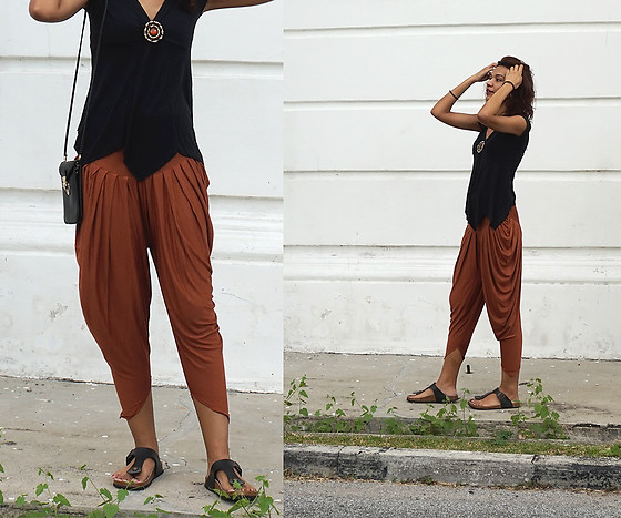 Shanaz AL - Asymmetrical Hem Black V Neck Top, Thrifted Brown Drop Crotch Pants, Local Boutique Birkenstock Style Sandals, Thrifted Rectangle Sling Bag - The Library Spirit