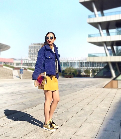 Carrie Tong - Cache Fluffy Wool Jacket, Zara Leather Skirt, Salvatore Ferragamo Gold Clutch, Adidas Sneakers - Colorblocking