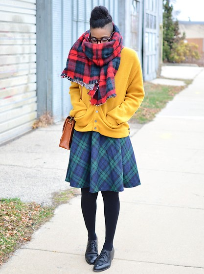 Sushanna M. - Reversible Plaid Blanket Scarf, Thrifted Vintage Men's Oversized Yellow Cardigan, Brown Braided Satchel, Blue Green Plaid Skirt, Thick Black Tights, Thrifted Vintage Men's Cap Toe Oxfords - Grand Central Station