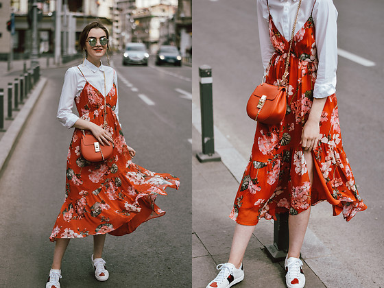 Andreea Birsan - Red Crossbody Bag, Red Floral Midi Dress, White Button Down Shirt, Ace Heart Sneakers, Round Mirrored Sunglasses - How to wear a midi skirt and sneakers II