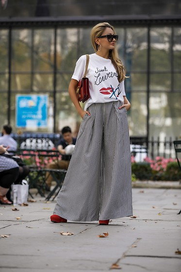 Lauren Recchia - Saint Laurent Graphic Tee, Zimmermann Striped Trousers, Prada Red Boots - Smoking Lips