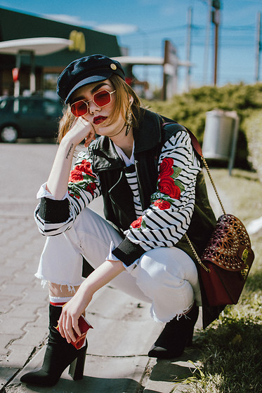 Andreea Birsan - Baker Boy Cap, Red Tinted Sunglasses, Striped Embroidered Top, Black Leather Vest, White Button Down Shirt, Statement Sunglasses, White Mom Jeans, Ruby Red Laceout Metropolis Bag, Black Ankle Sock Boots, Socks - Baker boy