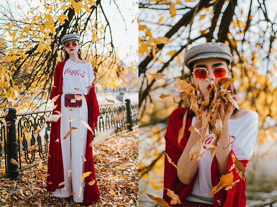 Andreea Birsan - Red Duster Coat, Coca Cola T Shirt, Check Printed Cap, Red Tinted Retro Sunglasses, Red Belt Bag, White Wide Leg Trousers, Red Sock Boots - Back to the 70s