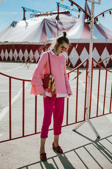 Andreea Birsan - Red Tinted Sunglasses, Pink Bell Sleeves Sweater, White Button Down Shirt, Hot Pink Trousers, Red Marmont Pumps, Coral Leather Camera Bag, Silk Scarf - Pink and red
