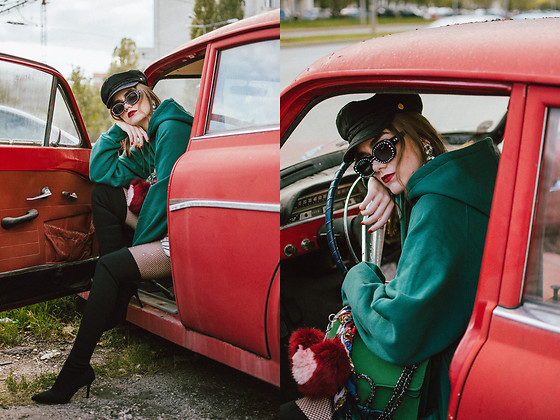 Andreea Birsan - Emerald Hoodie, Green Suede Shoulder Bag, Mini Floral Dress, Rhinestone Fishnet Tights, Over The Knee Sock Boots, Square Rhinestone 90s Sunglasses, Baker Boy Cap, Earrings, Fur Charm - Hoodie and dress