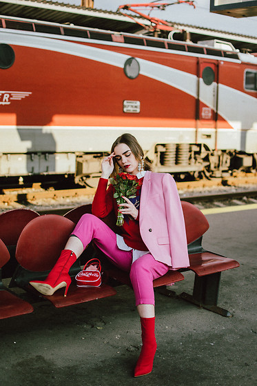 Andreea Birsan - Dusty Pink Blazer, Red Sweater, White Button Down Shirt, Hot Pink Peg Trousers, Heeled Red Sock Boots, Statement Earrings, Red Vinyl Mini Bag - Red and pink