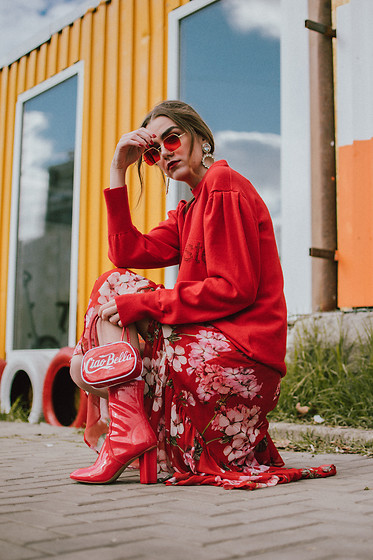 Andreea Birsan - Puffy Sleeves Red Cashmere Sweater, Retro Red Tinted Sunglasses, Rhinestone Earrings, Mini Vinyl Bag, Midi Floral Printed Dress, Red Patent Boots - All red