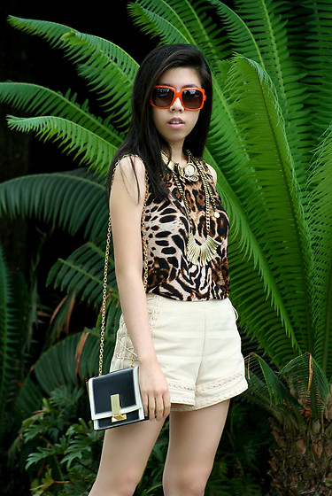 Adrienne Nguyen - Dior Sunglasses, Gold Fan Necklace, Cream Side Lace Up Shorts, Z Spoke Zac Posen Mini Loren Crossbody - Jaguar In The Wild
