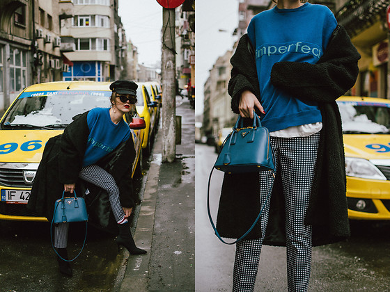 Andreea Birsan - Blue Cashmere Sweater, High Waisted Gingham Trousers, Bolsa A Mano Saffiano Lux Cobalt Blue Mini Bag, Black Heeled Sock Boots, 90s Socks, Oversize White T Shirt, Cat Eye Sunglasses, Baker Boy Hat, Long Teddy Bear Coat In Black, Gold Earrings - Monday blues