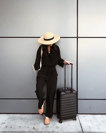 Tiffany Wang - Free People Hat, Grana Jumpsuit, Away Luggage - AIRPORT OUTFIT