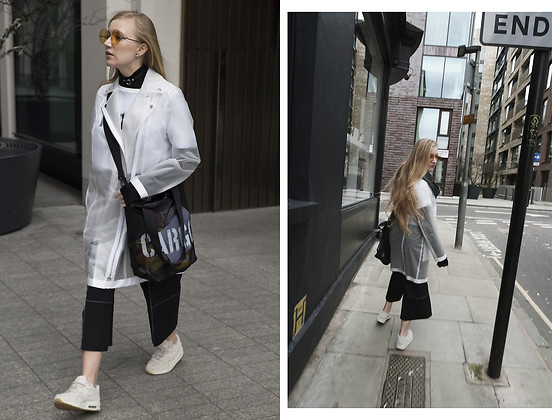 Ewa Michalik - Reserved Raincoat, Cargo Bag, Reserved Trousers, Nike Sneakers, For Art's Sake Sunglasses, Reserved T Shirt - LFW x Reserved