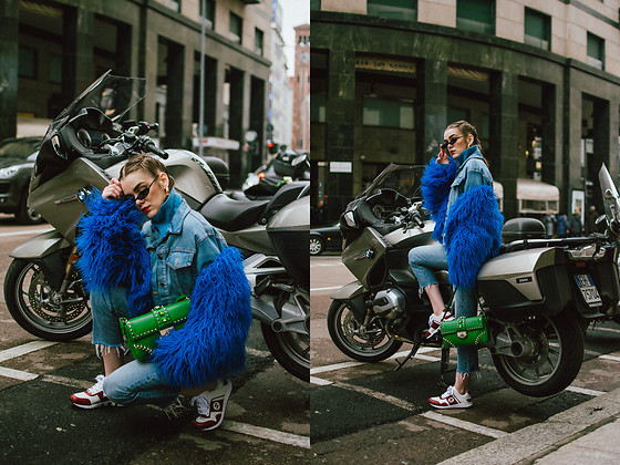 Andreea Birsan - Blue Faux Fur Jacket, Denim Jacket, Cropped Jeans, Gucci Sneakers, Green Prada Bag, Small Cat Eye Sunglasses - It's a blue kind of day