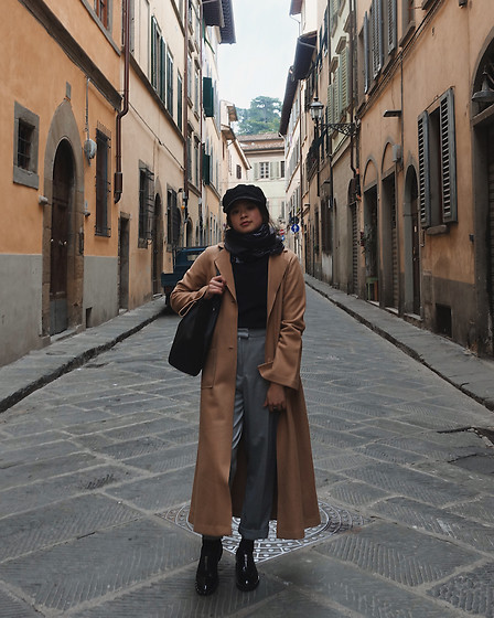 Olivia Corcoran - Urban Outfitters Baker Boy Hat, Light Scarf, Long Camel Coat, Zara Gray Trousers - European Inspo