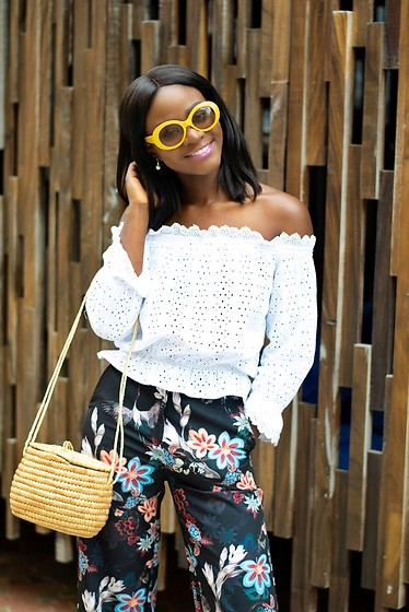 Iféoluwa Anani - Urban Outfitters Yellow Sunglasses, H&M Eyelet Over The Shoulder Top, H&M Floral Pants, Lekki Arts And Craft Market In Nigeria Basket Bag - Floral Pants & Basket Bag