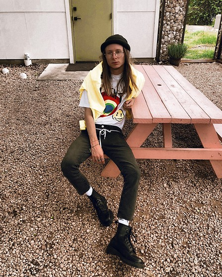 Dustin Faires - Dr. Martens Black Boots, Adidas White Crew Socks, Forever 21 Cut Black Denim Jeans, Shoestring Belt, Cactus Plant Flea Market Core Graphic Tee, Target Oversized Yellow Rainjacket, Carhartt Rolled Black Beanie - S M I L E Y
