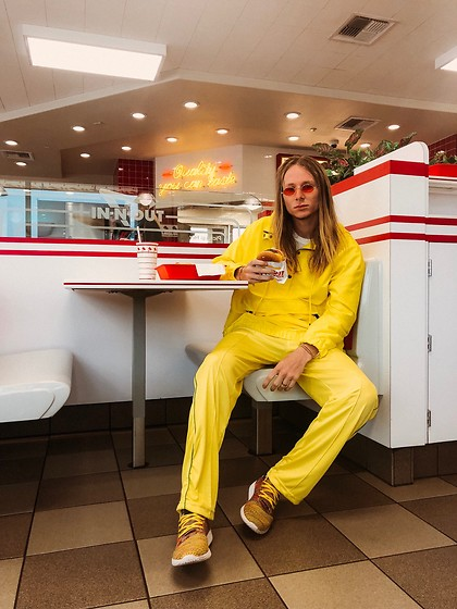Dustin Faires - Adidas Multi Colored Tennis Hu, Puma Yellow Athletic Pants, Target Oversized Yellow Raincoat, Urban Outfitters Red Tinted Sunglasses - M E L L O W