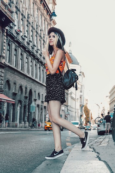 Wonderstyle - H&M Flower Pattern Yellow Top, Primark Mini Leather Backpack, Zara Polka Dot Pleated Shorts, Nike Sb Sneakers - Budapest Street Style