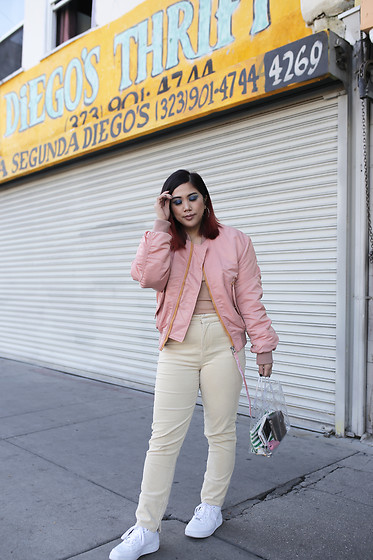 Yuka I. - Nude Tank, Ganni Yellow Corduroy Pant, Acne Studios Bomber Jacket, Clear Shopper Tote, Nike Air Force - Pink bomber