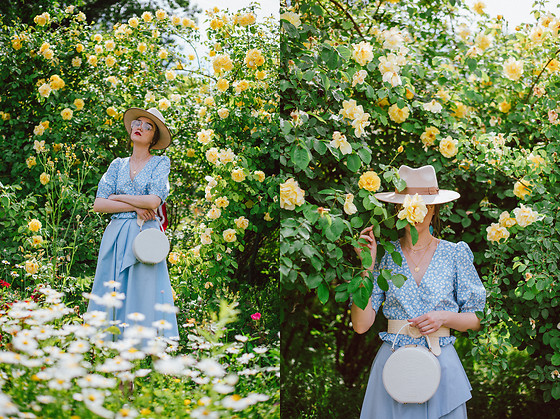 Andreea Birsan - Beige Fedora Hat, Floral Print Baby Blue Top, White Leather Round Bag, Baby Blue Midi Skirt, Straw Belt, Clear Lens Aviator Glasses - The romantic baby blue outfit