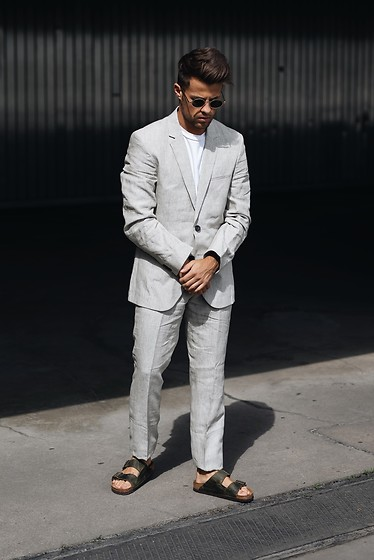 Kevin Elezaj - Birkenstock Sandals, Hugo Boss Suit, Prada Glasses - Linen suit