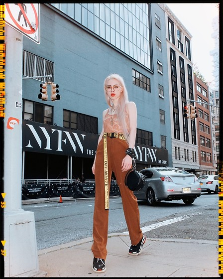 Emmalynn V - Jessica Buurman Ugly Dad Sneakers, Jessica Buurman Brown High Waisted Wide Leg Pants, Off White Off White Industrial Belt, Gucci Nerd Glasses, Nude Lace Top - NYFW New York Fashion Week