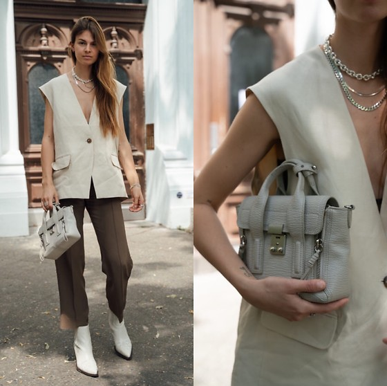 Jacky - Arket Vest, Arket Suit Pants, 3.1 Phillip Lim Small Bag, Via Omoda Cowboy Boots, Black Palms The Label Accessories - Chic outfit with a blazer vest