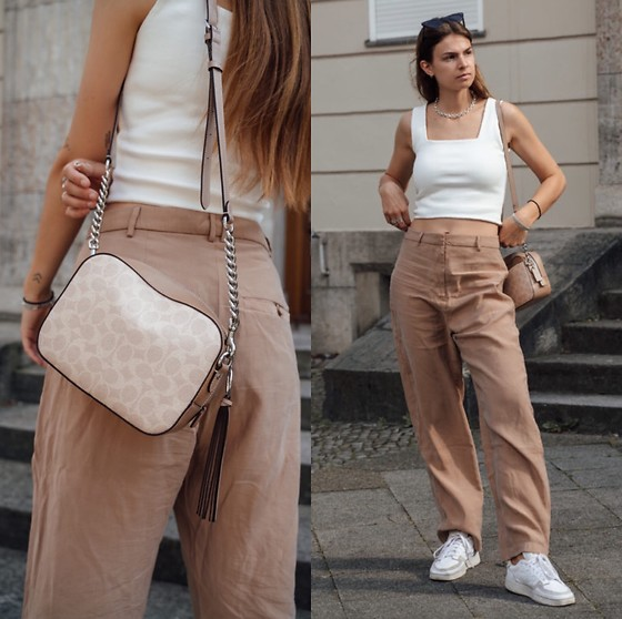 Jacky - Adidas White Sneaker, Weekday Wide Pants, Nudyess Cropped Top, Coach Small Bag - Cropped top and pants with wide fit