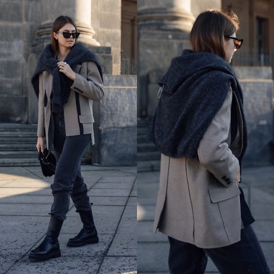 Jacky - Toral Black Boots, Noisy May Black Jeans, Mybestfriends Blazer, Arket Knitted Sweater, Prada Small Bag, Saint Laurent Cateye Sunglasses - Casual chic outfit with a sweater around the shoulders