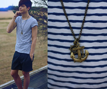 Yannick K. - Topman Navy Shorts, H&M Striped T Shirt - A little crisco and some fishing wire and we'll be in business.