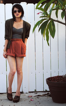 Trang Huyen - Structured Shoulder Jacket, Vtg. Shorts, Miu Clogs, Oversize Aviators - Olive juice.