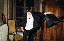 Romain Le Cam - Hand Made Black Satin Hand Made Cape, Agnès B Black Coton Suit Jacket, April 77 Black Skinny Jeans, Vivienne Westwood White Cotton Shirt, Weekday Black Coton Tank - French Castle Released Party