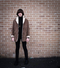 Jack Spicer Adams - Second Hand Shop Black Turtle Neck, Made It Key Necklace, Second Hand Shop Sheepskin Coat, Tight Black Chords, Second Hand Shop Black Brogues - Lock.