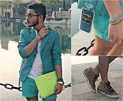 Ali Al-Bana - Chanel No.5 Iphone Cover, Zara Leopard Gold Studded Shoes, Marc By Jacobs Neon Case, H&M Turquoise & Camel Colored Bracelet, Rolex Gold Watch, Custom Designed Blazer, Abercrombie And Fitch White Linen Shirt, H&M Turquoise Shorts - We Are Golden - Mika