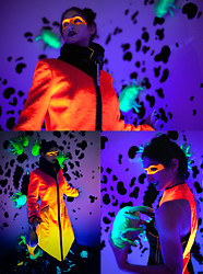 The Girl Mirage® - Shane Maxwell Furry Coat, Shane Maxwell Glowing Purse, Shane Maxwell Uv Dress, Brett Sylvia Multimedia Blacklight Installation - Fluorotoxin
