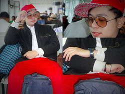 Lee Uno Ong - Aldo Snap Back, Ray Ban Aviator, H&M Woven Cardigan, Diesel Fashion Watch, Celio Red Slim Pants - Rouge Flight KSA