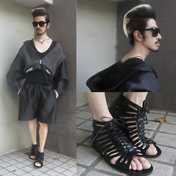 Andre Judd - Renan Pacson Neoprene And Wool Cropped Jacket With Oversized Sleeves, Buern Rodriguez Haute Coiffure, Mundo Leather Sandals, Renan Pacson Neoprene Shorts, Alexander Wang Scooped Neck Tee - JETBLACK