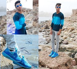 Saad Mouhannad - Celio Sweater, April 77 Jean, Nike Shoes - Calm before the storm