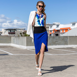 Dasha Gold - Nicola Finetti Cobalt Blue Knee Length Skirt, Sheike Art Print Crop Top, Sachi White Sandals, Shakuhachi Sunglasses - Color Pops & Art Brushes