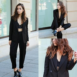 RUTA GYVYTE -  - A GIRL IN A SUIT